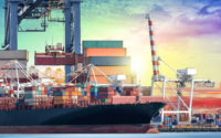 Logistics and transportation of International Container Cargo ship with working crane bridge in seaport for logistic import export background and transport industry.